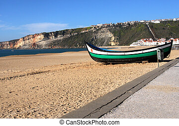 boat on the beach in nazare