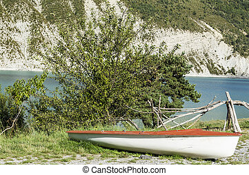 Boat on the beach of the lake