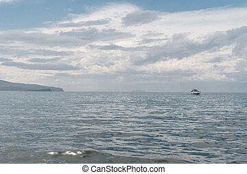 boat on the horizon of lake baikal