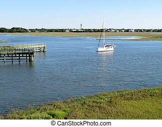 Boat on the marsh and wetlands along Shem Creek in Charleston, South Carolina