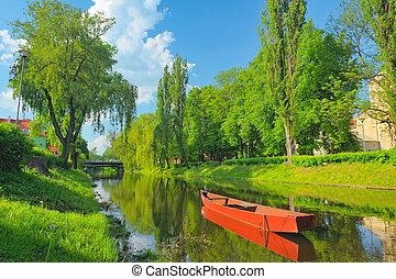 Boat on the Narew river. Spring landscape.