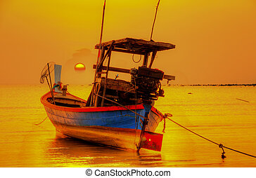 boat on the ocean at sunset