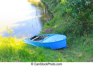 Boat on the river shore