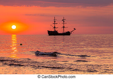 Boat on the sea at sunset in Baltic Sea, Poland.