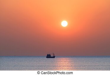 Boat on the sea at sunset