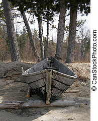 Boat on the shore of Lake Baikal. Buryatia. Siberia.