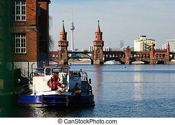 boat on the Spree in front of the Berlin Oberbaumbridge