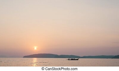boat on the water at sunset