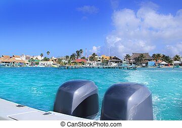 boat outboard stern with prop wash foam Isla Mujeres
