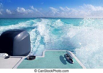 boat outboard stern with prop wash caribbean foam - boat...