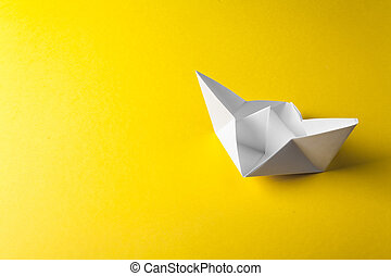boat paper origami on the yellow background