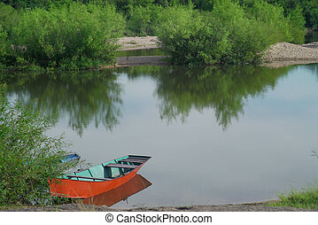 boat parked on the river bank