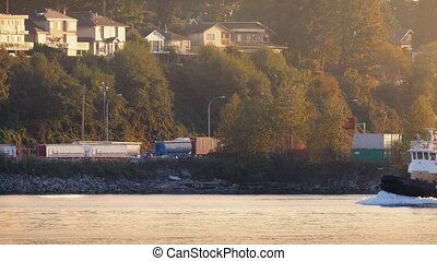 Boat Passes Houses At Sunrise - Small Ship Passes By Road...