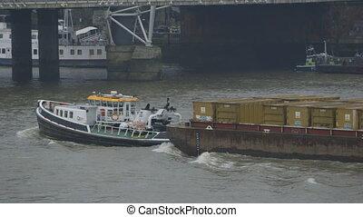 Boat Pulling Cargo Ships - Handheld, medium close up shot of...