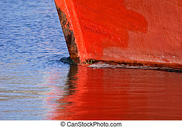 Boat reflection - Red hull of a boat with reflection in the ...