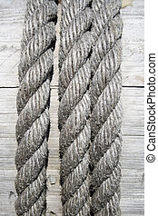 Boat rope on wooden background