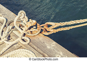 Boat rope tied to pier
