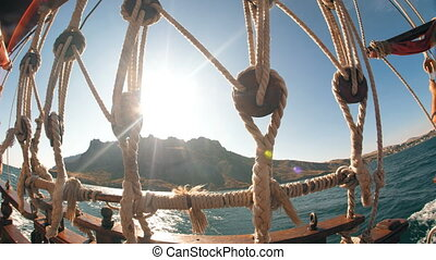 Boat ropes sea and sun - view from the stern of the pirate...