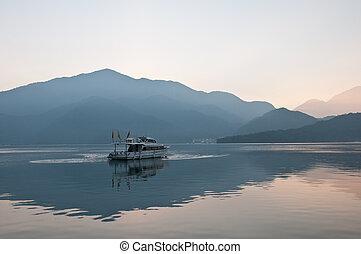 Boat sail calmly in Sun Moon Lake Taiwan