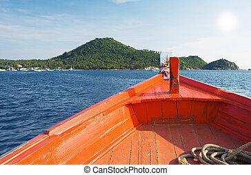 boat sail to tropical island