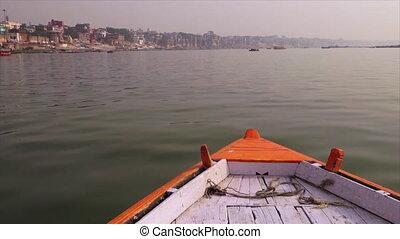 Boat sailing along the sacred River Ganga, India - Wide...