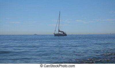 Boat sailing by the sea