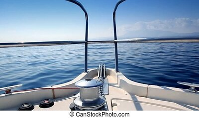 boat sailing in a calm blue sea
