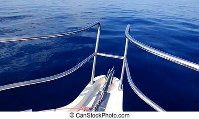 boat sailing in a calm blue sea
