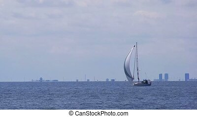 Boat sailing on open blue sea