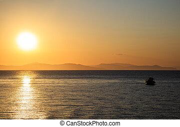 Boat sailing on still water in sunlight