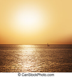 Boat sailing on the sea at sunset