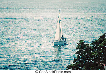 boat sailing on the wide blue sea