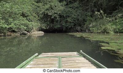 Boat sailing to the dark islet cave. Trang An, Vietnam -...