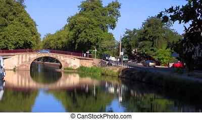 boat sails under the bridge