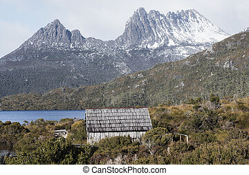 Boat shed in Dove Lake, Tasmania on a snowy and overcast...