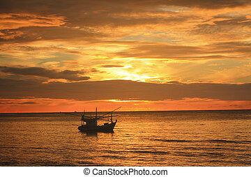 Boat silhouette on sea.