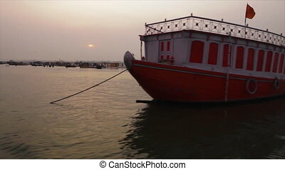 Boat silhouettes along the Ganga at sunset, India - Wide...