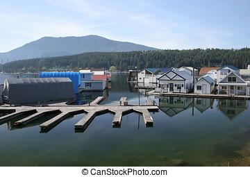 Boat slips. - Empty boat slips on calm water.