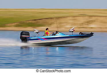 Boat speed - fast bass boat speeding to the fishing hole