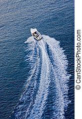 Boat Speeding Away