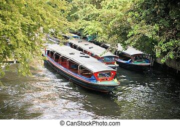 Boat speeding on San Saep canal in Bangkok, Thailand