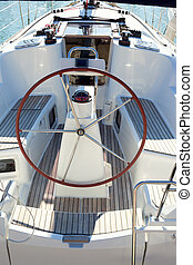 boat stern with big steering wheel sailboat