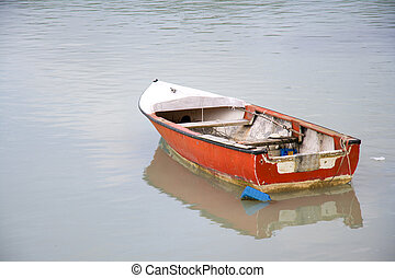 Boat - Small old boat is anchored in the bay