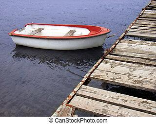 Boat tied to the qua