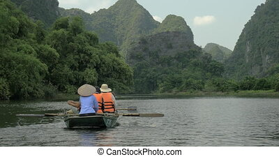 Boat tour along the river in Ha Long Bay, Vietnam