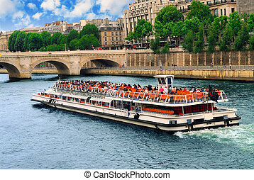 Boat tour on Seine river in Paris, France