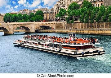 Boat tour on Seine river in Paris, France