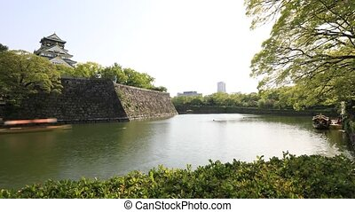 Golden Wasen touristic boats time lapse on the moat of Osaka Castle the best activities you can experience around Osaka Castle area, one most famous landmarks of Japan