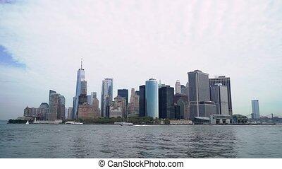 Boat trip around new York city, USA. Hudson Bay, the Brooklyn bridge and the towers of Lower Manhattan