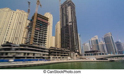 Boat trip on the ship-restaurant by the channel in Dubai Marina. Dubai, UAE timelapse hyperlapse